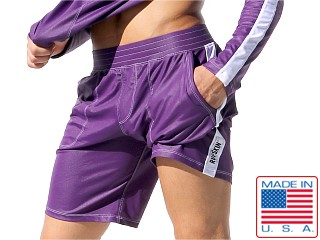 Model in eggplant Rufskin Daytona Stretch Sport Shorts