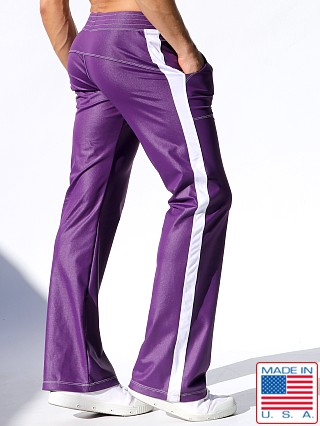Model in eggplant Rufskin Shift Stretch Sport Pants