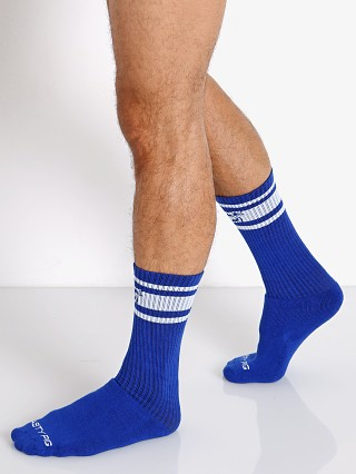 Model in surf blue Nasty Pig Hook'd Up Sport Socks