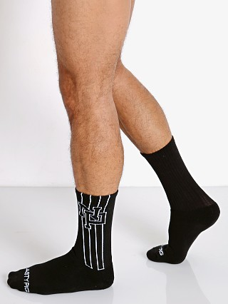 Model in black Nasty Pig Interlock Socks