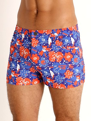 Model in royal/red floral St33le Pacer Swim Shorts