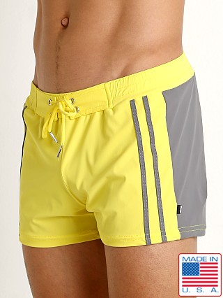 Model in yellow/grey Sauvage Moderno Two-Tone Swim Trunk