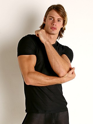 Model in black Gregg Homme Physical Modal V-Neck Tee