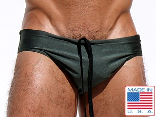 Model in army Rufskin Lap Metallic Shine Nylon Sunga Swim Brief