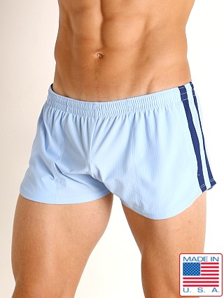 Model in baby blue/navy LASC Performance Mesh Running Shorts