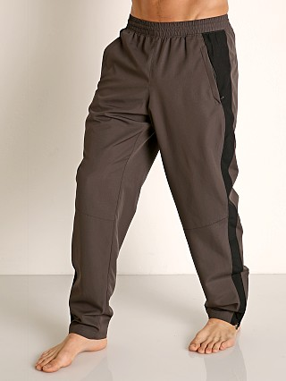 Model in charcoal Under Armour Sportstyle Woven Pant