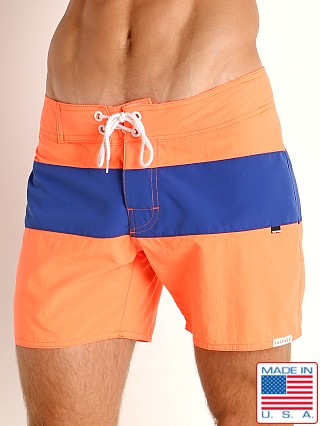 Model in orange/royal Sauvage Miami Brights Board Shorts