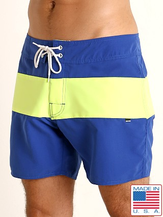 Model in royal/lime Sauvage Miami Brights Board Shorts