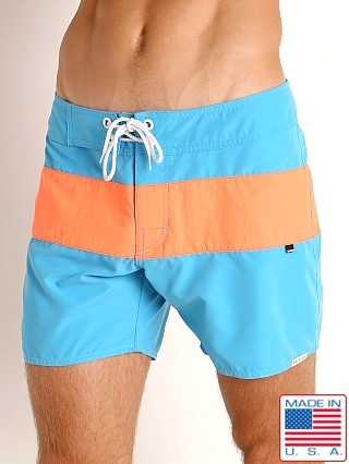 Model in turquoise/orange Sauvage Miami Brights Board Shorts