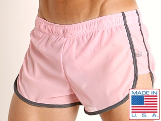Model in pink American Jock Elite Sport Lined Track Short