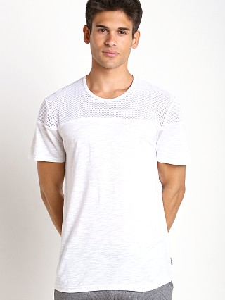 Model in white 2xist Modern Sport Open Mesh Textured Jersey T-Shirt