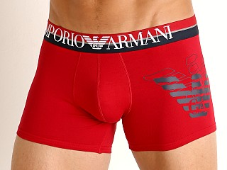 Model in cherry Emporio Armani Double Eagle Trunk