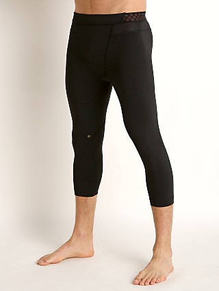 Model in black/black Under Armour Rush 3/4 Legging