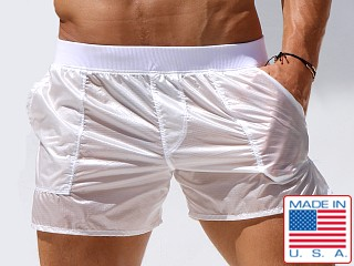 Model in white Rufskin Nuage Transparent Nylon Pocket Shorts