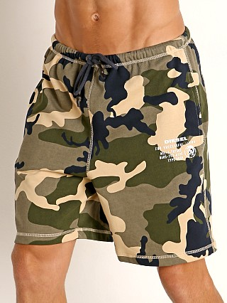 Model in camo khaki Diesel Eddy Camo Shorts