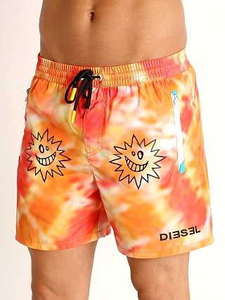 Model in orange tie dye Diesel Wave 2.017 Swim Shorts