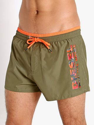 Model in olive Diesel Sandy Swim Shorts