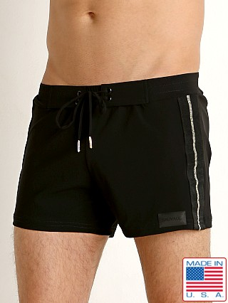 Model in black/gold Sauvage Retro Lycra Metallic Stripe Swim Trunk