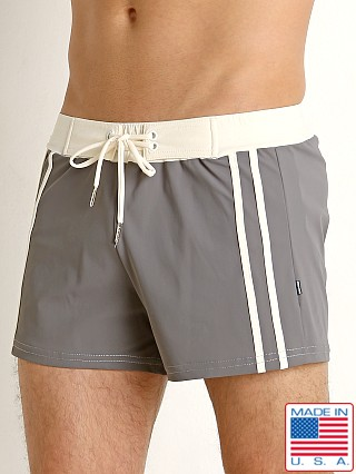 Model in charcoal/creme Sauvage Superwear Swim Trunk