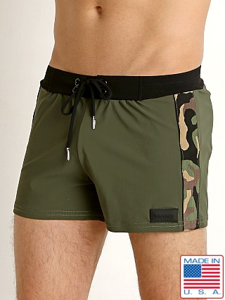 Model in army/camo Sauvage Superwear Swim Trunk