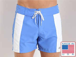 Model in french blue/white Sauvage Boardwalk Surf Trunks