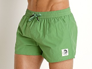 Model in olive green Diesel Caybay Short Swim Shorts