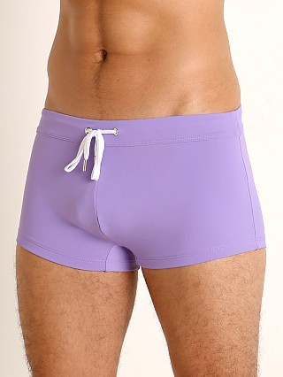 Model in new purple 2xist Cabo Sliq Swim Trunk