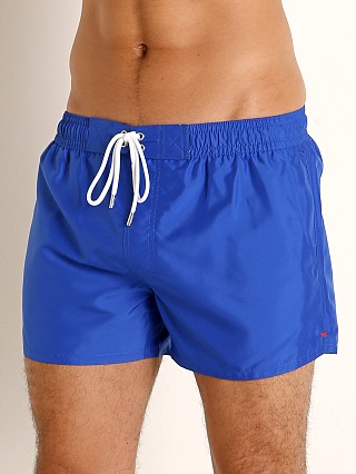 Model in blacklight blue 2xist Ibiza Swim Shorts