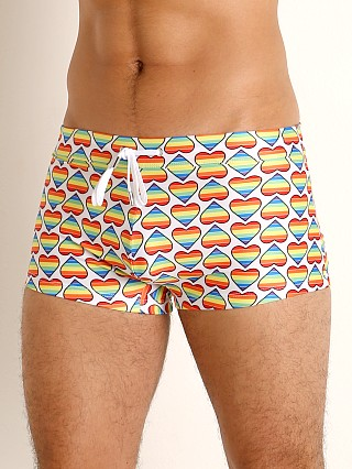 Model in bold hearts rainbow 2xist Pride Cabo Sliq Swim Trunk