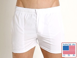 Model in white LASC Malibu Swim Shorts