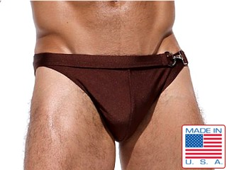 Model in brown Rufskin Boxol Dual-Waisted Calkini Swim Briefs