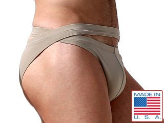 Model in khaki Rufskin Boxol Dual-Waisted Calkini Swim Briefs