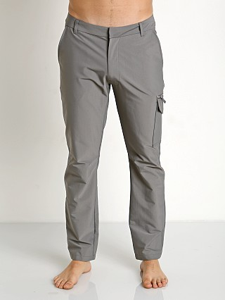 Model in grey 2xist Core Travel Pants