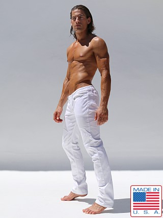 Model in white Rufskin Berm Padded Knee Jeans