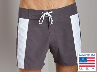 Model in charcoal/white Sauvage Boardwalk Surf Trunks