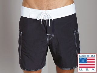 Model in black/white Sauvage Pocketed Board Shorts