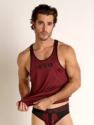 Model in burgundy Cell Block 13 Cyclone 2.0 Tank Top