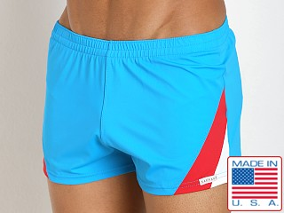 Model in turquoise Sauvage European Nylon Lycra Color Block Swim Trunk