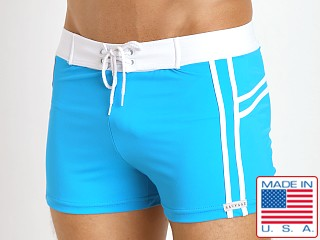 Model in turquoise Sauvage Mariner Stripes Italian Lycra Swim Trunk