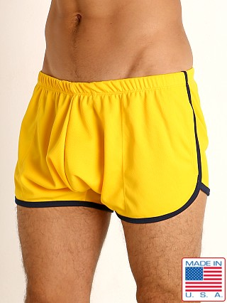 Model in gold/navy Rick Majors Pique Mesh Bulge Shorts