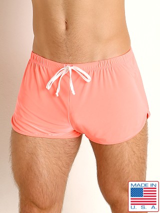 Model in coral Rick Majors Glossy Flow Lounge Shorts