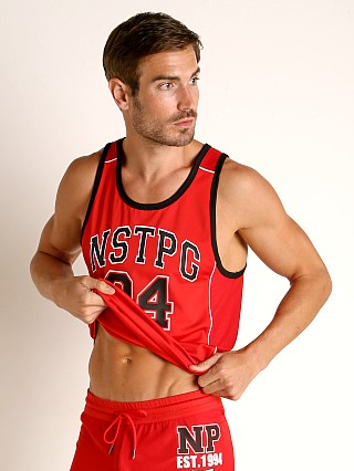 Model in red Nasty Pig Crews Tank Top