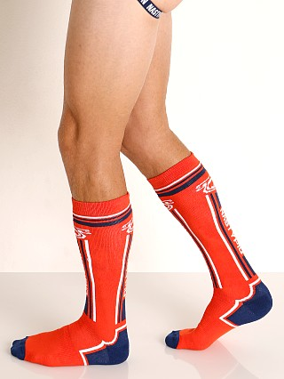Model in orange Nasty Pig Impulse Socks
