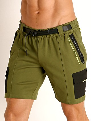 Model in green Nasty Pig Trail Short
