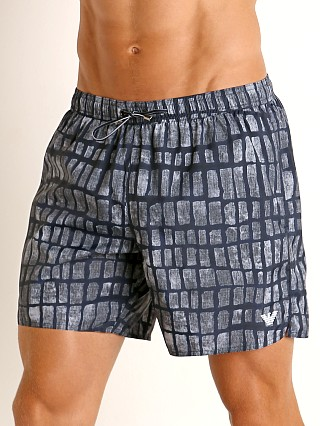 Model in blue cocco print Emporio Armani Animalier Swim Shorts