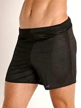 Model in black McKillop Push Expose Mesh Fitness Shorts