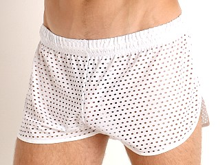Model in white McKillop Ignite Glory Mesh Shorts