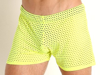 Model in neon yellow McKillop Shadow Glory Mesh Shorts
