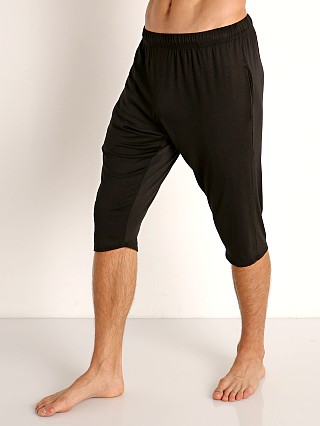 Model in black McKillop Modal Sliders Sports and Lounge Shorts