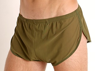 Model in army McKillop Ultra Stretch Mesh Running Shorts